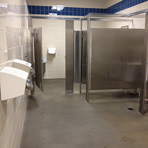 rest area men's restroom stalls and blow dryers